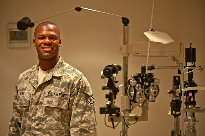 Air Force Staff Sgt. Robert Niter III, 47th Medical Operations Squadron NCO in charge of optometry, poses for a photo in the optometry clinic at Laughlin Air Force Base, Texas, Sept. 19, 2013. During a recent visit to Houston, Niter used his medical knowledge and intuition when he saw a downed pedestrian unconscious and not breathing. His quick lifesaving actions revived and kept the pedestrian alive until rescue personnel arrived on-scene. (U.S. Air Force photo/Senior Airman Scott Saldukas)