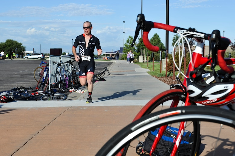Leslie Handy, 460th Medical Group, sprints to the finish of the 2nd Annual Buckley Duathlon Sept. 19, 2013, on Buckley Air Force Base, Colo. The race started with a 2-mile run, followed by a 6-mile bike ride and finished with a 1.5-mile run. (U.S. Air Force photo by Airman 1st Class Riley Johnson/Released)