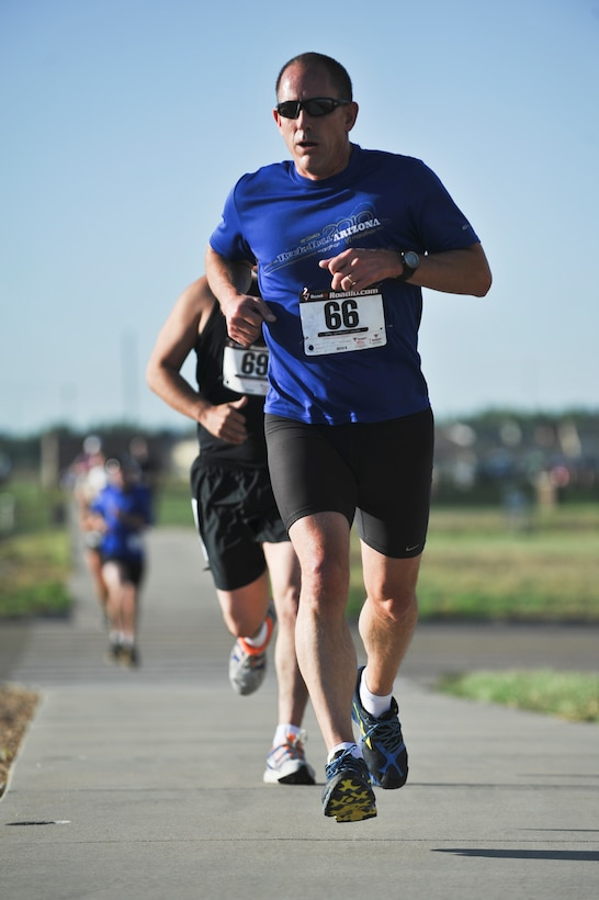 Mark Meyer runs first leg of the 2nd Annual Buckley Duathlon Sept. 19, 2013, on Buckley Air Force Base, Colo. The race started with a 2-mile run, followed by a 6-mile bike ride and finished with a 1.5-mile run. (U.S. Air Force photo by Airman 1st Class Riley Johnson/Released)