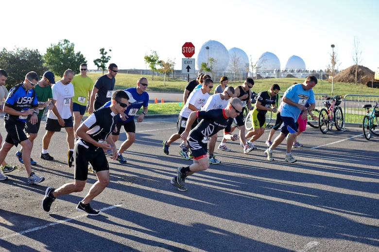 Team Buckley members begin the 2 mile portion of the 2nd Annual Buckley Duathlon Sept. 19, 2013, on Buckley Air Force Base, Colo. The race started with a 2-mile run, followed by a 6-mile bike ride and finished with a 1.5-mile run. (U.S. Air Force photo by Airman 1st Class Riley Johnson/Released)
