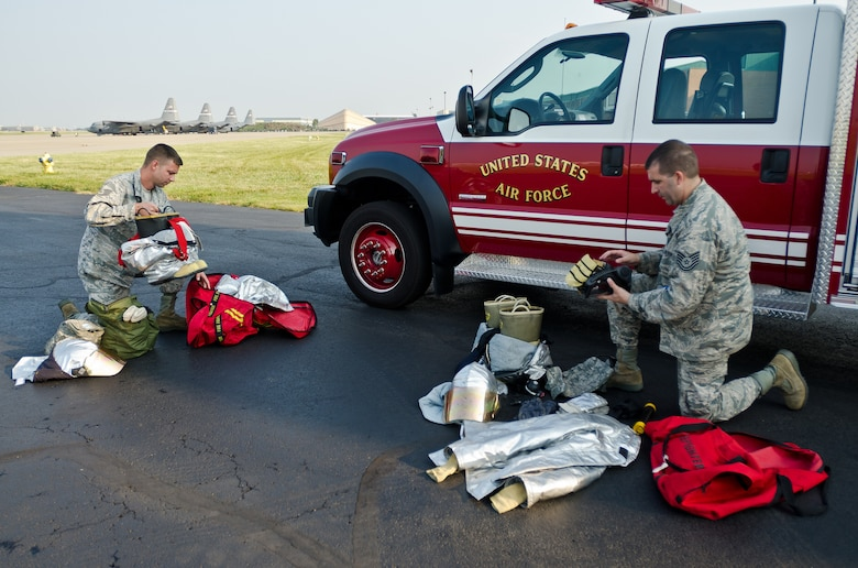 Staff Sgt. Kyle Miller (left) and Tech. Sgt. Dewayne Gibson, fire protection craftsmen from the 123rd Civil Engineer Squadron, inspect firefighting equipment Sept. 10, 2013, at the Kentucky Air National Guard Base in Louisville, Ky., prior to an overseas deployment. More than 85 Kentucky Air Guardsmen are being mobilized to support Air Expeditionary Force rotations and other Air Force missions this summer and fall. (U.S. Air National Guard photo by Master Sgt. Phil Speck)