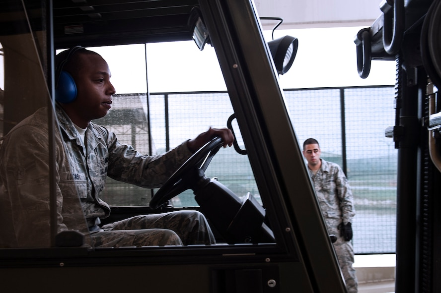 Airman 1st Class Lorenzo Lucas, 39th Logistics Readiness Squadron hazardous materials journeyman, drives a forklift Sept. 18, 2013, at Incirlik Air Base, Turkey.  Lucas is responsible for the shelf-life of materials in the HAZMAT warehouse. (U.S. Air Force photo by Airman 1st Class Nicole Sikorski/Released)