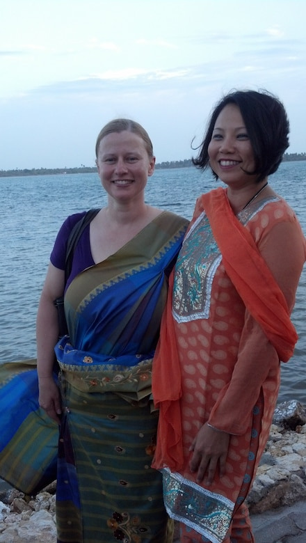 Dr. Erika Petrik, a family pratice doctor from Hawaii and Lt. Col. Thuy Tran wear some of the traditional clothing during the cultural celebration as part of the Pacific Angel Mission, Jaffna Peninsula of Sri Lanka, July 28-Aug.18, 2013. (photo courtesy of Master Sgt. Dana Furnia, 142nd Fighter Wing Medical Group)