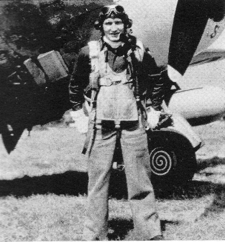 Capt. Uno A. Salmi, 406th Fighter Squadron, smiled for the camera in his flying gear next to a P-47 Thunderbolt.  He was one of the 406th senior pilots who conducted experimental takeoffs on a new advanced landing ground-style runway in England before the unit deployed forward to France.  Two takeoffs were safely made, each with a belly tank and two bombs; two 240-lb bombs the first time and two 500-lb bombs the second time, to make sure the new surface was safe for the group's flight operations.  He went MIA on 16 June 1944.