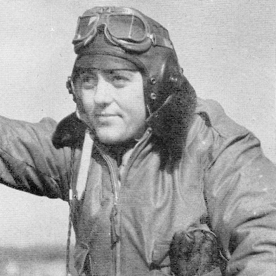 F/O Edwin S. Humphreys, 404th Fighter Squadron, struck a pose for the camera in his flying gear in this undated photograph.  He went MIA on 8 June 1944