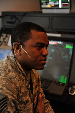 U.S. Air Force Staff Sgt. Kirk Cash, 509th Operation Support Squadron air traffic controller, simulates communication with local aircraft at Whiteman Air Force Base, Mo., Sept. 9, 2013. The simulator is used to train Airmen in scenarios involving air traffic volume and other emergencies. (U.S. Air Force photo by Airman 1st Class Keenan Berry/Released)