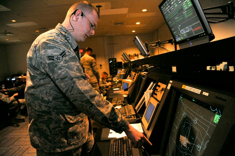 """U.S. Air Force Airman 1st Class Derek Barb, 509th Operation Support Squadron air traffic control apprentice, gives a """"point out"""" to the arrival controller at Whiteman Air Force Base, Mo., Sept. 9, 2013. Point outs are used to alert the incoming controller of any aircraft within the airspace. (U.S. Air Force photo by Airman 1st Class Keenan Berry/Released)"""