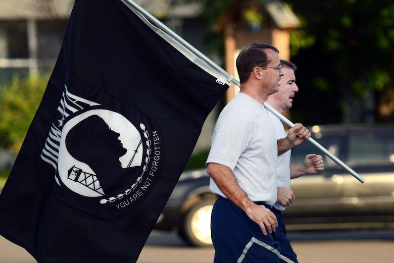 U.S. Air Force Col. Stephen Williams, 35th Fighter Wing commander, front, and Chief Master Sgt. Gary Sharp, 35 FW command chief, begin the first leg of a remembrance run at Misawa Air Base, Japan, Sept. 19, 2013. To honor all of the prisoners of war and those missing in action, the 35 FW ran 24 hours straight for the POW/MIA Remembrance Day. (U.S. Air Force photo by Airman 1st Class Zachary Kee)