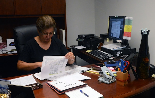 Dorothy Sarmiento, 36th Civil Engineer Squadron Tinian Hall dorm manager, poses for a photo Sept. 19, 2013, on Andersen Air Force Base, Guam. The dorm managers at Andersen are responsible for maintaining the dorm rooms, ensuring each Airman is housed safely and comfortably. (U.S. Air Force photo by Airman 1st Class Mariah Haddenham/Released)