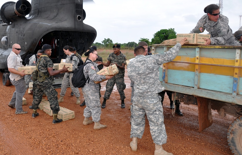 Members of Joint Task Force-Bravo work with members of the Honduran military to offload medical supplies from a CH-47 Chinook helicopter at Puerto Lempira, Honduras, Sept. 21, 2013.  Joint Task Force-Bravo partnered with the Honduras Ministry of Health to coordinate the movement of more than 140 boxes of medical supplies from Soto Cano Air Base to Puerto Lempira.  The medical supplies will be used at a local hospital.  (U.S. Air Force photo by Capt. Zach Anderson)