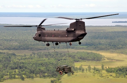 A CH-47 Chinook helicopter assigned to Joint Task Force-Bravo makes its return flight from Puerto Lempira, Honduras, to Soto Cano Air Base while carrying a sling-loaded environmental control unit weighing more than 4,800 pounds, Sept. 21, 2013. The environmental control unit was used to support JTF-Bravo's mobile surgical team while they provided medical assistance in the Gracias a Dios region of Honduras. (U.S. Air Force photo by Capt. Zach Anderson)