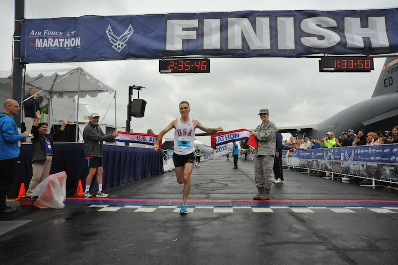 James Beyer, 46, of Dayton, Ohio, crosses the finish line to win the U.S. Air Force Marathon's men's full marathon event at 2:35:47, Sept. 21, 2013, at Wright-Patterson Air Force Base, Ohio. (U.S. Air Force photo/Michelle Gigante)