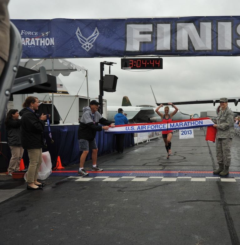 Michelle Farr, 40, of Medina, Ohio, crosses the finish line to capture the U.S. Air Force Marathon women's full marathon event at a time of 3:04:44, Sept. 21, 2013, at Wright-Patterson Air Base, Ohio. (U.S. Air Force photo/Michelle Gigante)