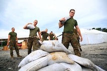 U.S. Marines with Battalion Landing Team 1/4, 13th Marine Expeditionary Unit, stack sandbags in preparation for Amphibious Landing Exercise 2014 at Crow Valley, Philippines, Sept. 17, 2013.  PHIBLEX is a bilateral training exercise designed to demonstrate the United States and Republic of the Philippines commitment to mutual security and strengthen our long-term partnership, while ensuring the readiness of a bilateral force able to rapidly respond to regional humanitarian crises.