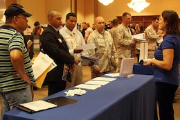 Service members browse through booths at the Hiring our Heroes job fair at the Pacific Views Event Center here Sept. 19. The fair was held to help service members who are transitioning back into civilian life find work.