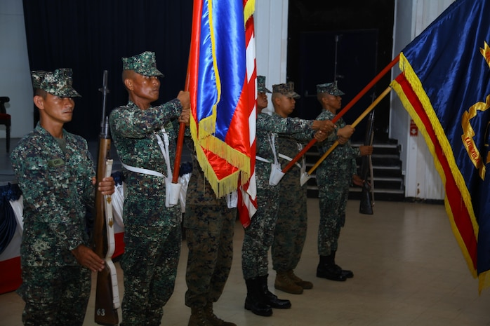 Philippine and U.S. Marines present organizational colors during the opening ceremony of Amphibious Landing Exercise 2014 at Naval Station Leovigildo, Sept. 18. PHIBLEX 14 is an annual, bilateral training exercise that enhances security and stability within the region while also helping to prepare for humanitarian assistance and disaster relief missions. During the exercise, U.S. Marines, from the 13th Marine Expeditionary Unit, 3d MEB and III Marine Expeditionary Force, will partner with Philippine Marines.