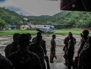 U.S. and Philippine Marines conduct helocast training during Amphibious Landing Exercise 2014 (PHIBLEX 14) at Marine Barracks Gregorio Lim, Ternate, Cavite, Republic of the Philippines, Sept. 18, 2013. Bilateral training during PHIBLEX 14 ensures Philippine and U.S. forces are capable of integrating effectively to conduct humanitarian assistance and regional security missions. The U.S. Marines are with Force Reconnaissance Platoon, Maritime Raid Force, 13th Marine Expeditionary Unit. The Philippine Marines are with Force Reconnaissance Battalion. (U.S. Marine Corps photo by Sgt. Ammon W. Carter, 13th Marine Expeditionary Unit Combat Camera/Released)