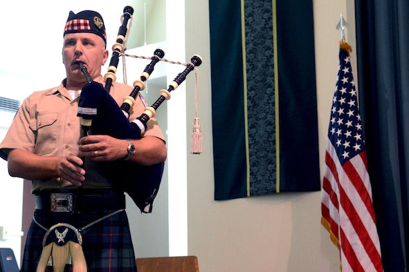 Master Sgt. Iain Morrison, 554th RED HORSE Squadron engineering superintendent, plays bagpipes during the National Prisoner of War/Missing in Action Recognition Day ceremony on Andersen Air Force Base, Guam, Sept. 20, 2013. The ceremony followed a 24-hour vigil run on base which was held to honor prisoners of war and those missing in action. (U.S. Air Force photo by Airman 1st Class Mariah Haddenham/Released)