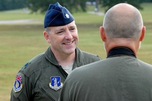 HOOVER, Ala. -- Lt. Col. Michael Phillips speaks to Joe Songer, a reporter from the Birmingham News, during an interview at the POW/MIA walk here on Friday. Phillips' father was an F-4 weapon systems operator in the Air Force and was shot down during the Vietnam War. His father was never found and was declared missing in action. (U.S. Air National Guard photo by Maj. Pam Carroll/Released)