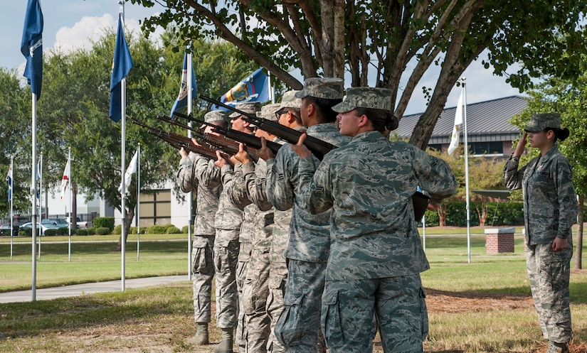 Airmen from the Joint Base Charleston Honor Guard render a 21-gun salute during the Prisoner of War/Missing in Action retreat ceremony Sept. 23, 2013, at JB Charleston – Air Base, S.C. (U.S. Air Force photo/Senior Airman Ashlee Galloway)