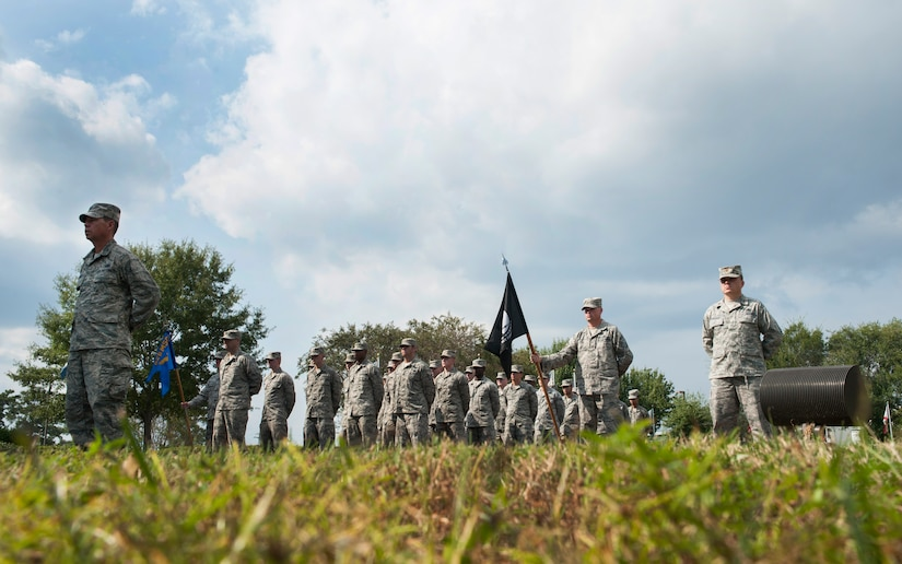 Joint Base Charleston Airmen stand in formation during the Prisoner of War/Missing in Action retreat ceremony Sept. 23, 2013, at Joint Base Charleston – Air Base, S.C. The empty formation on to the right represents servicemembers who are missing in action. (U.S. Air Force photo/Senior Airman Ashlee Galloway)