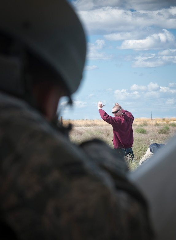 A U.S. Air Force Airman from the 726th Air Control Squadron shouts to direct a simulated foreigner during an exercise Sept. 18, 2013, at Mountain Home Air Force Base, Idaho. To prepare for deployments, 726th ACS Airmen must go through expeditionary combat skills training to equip them with the tools to successfully carry out their mission. Knowing how to properly, and legally, detain a foreigner is crucial to base security and to prevent enemy forces from infiltrating their position. (U.S. Air Force photo by Airman 1st Class Brittany A. Chase/Released)