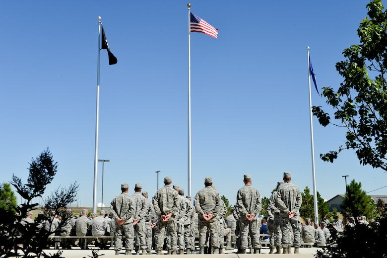 Team Buckley service members stand at parade rest during the National POW/MIA Recognition Day ceremony Sept. 20, 2013, at the 460th Space Wing headquarters building on Buckley Air Force Base, Colo. According to the Defense Prisoner of War/Missing Personnel Office, more than 83,000 Americans are missing from World War II, the Korean War, the Cold War, the Vietnam War and the 1991 Gulf War. (U.S. Air Force photo by Staff Sgt. Paul Labbe/Released)