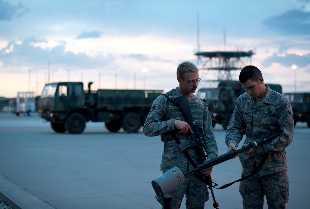 U.S. Air Force Airman 1st Class Ian Callahan, 726th Air Control Squadron radio frequency transmissions systems apprentice, clears his weapon with the supervision of Airman 1st Class Joshua Sparks, 726th ACS vehicle equipment maintenance specialist, Sept. 17, 2013, at Mountain Home Air Force Base, Idaho. Before Airmen could participate in the expeditionary combat skills training exercise, they had to make sure safety precautions were taken by clearing individual weapons. Once cleared, Airmen attached blank firing adapters, which are required for blank ammunition to function properly. (U.S. Air Force photo by Airman 1st Class Brittany A. Chase/Released)