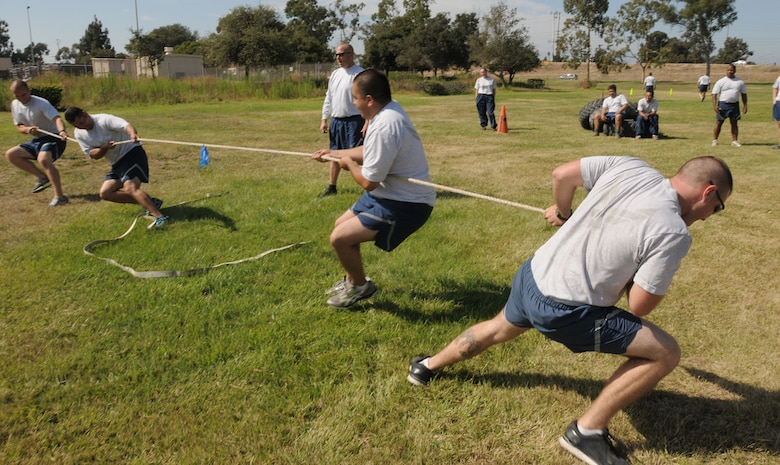 Senior Airman Randall Van Woerkom, Tech. Sgt. Jose Duarte, Senior Airman Ellis Garcia and Staff Sgt. Jeff Toyne member of the 146th Civil Engineers compete in the tug-o-war event near our front gate during their PT session on Sunday of last drill. CE finds different ways each month to accomplish fitness training, promote a healthy lifestyle and have fun while they are doing it. Air National Guard photo by Master Sgt. Dave Buttner