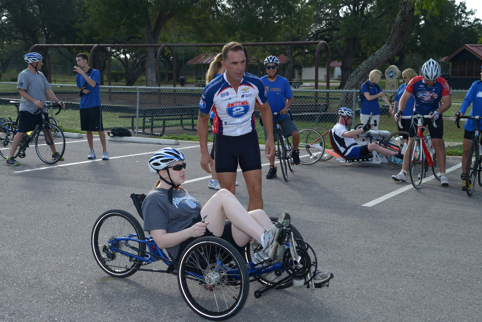 Troy Foster, Air Force Wounded Warrior Program Adaptive Sports Camp coordinator, discusses the cycling route with retired Staff Sgt. Megan Lyon Sept. 18 at Joint Base San Antonio-Randolph. The camp was provided by the Air Force Wounded Warrior Program, which introduces wounded, injured and ill Airmen to adaptive sports, such as wheelchair basketball and sitting volleyball, as early in the healing process as possible to get them interested in competing locally, or even at the national level at the Warrior Games in Colorado Springs, Colo. (U.S. Air Force photo by Joel Martinez/Released)