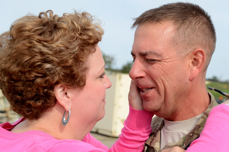 SPANGDAHLEM AIR BASE, Germany – U.S. Air Force Master Sgt. Scott Love, 52nd Equipment Maintenance Squadron NCO in charge of armorment from Pensacola, Fla., reunites with his wife, Kendall, Sept. 21, 2013. Love returned from his six-month deployment to Southwest Asia in support of Operation Enduring Freedom and was among the first to see his family after getting off the plane. (U.S. Air Force photo by Airman 1st Class Kyle Gese/Released)