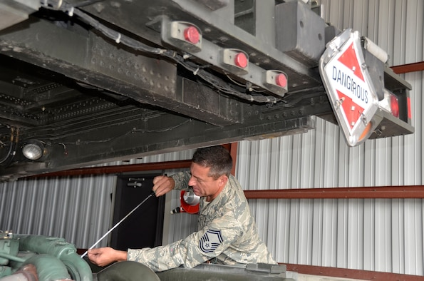 WRIGHT-PATTERSON AIR FORCE BASE, Ohio - Senior Master Sgt. John Westermeyer, 87th Aerial Port Squadron passenger services superintendent, checks the engine of a 60K loader, a vehicle that can load and unload cargo from all military and commercial cargo aircraft. (U.S. Air Force photo/Master Sgt. Charlie Miller)