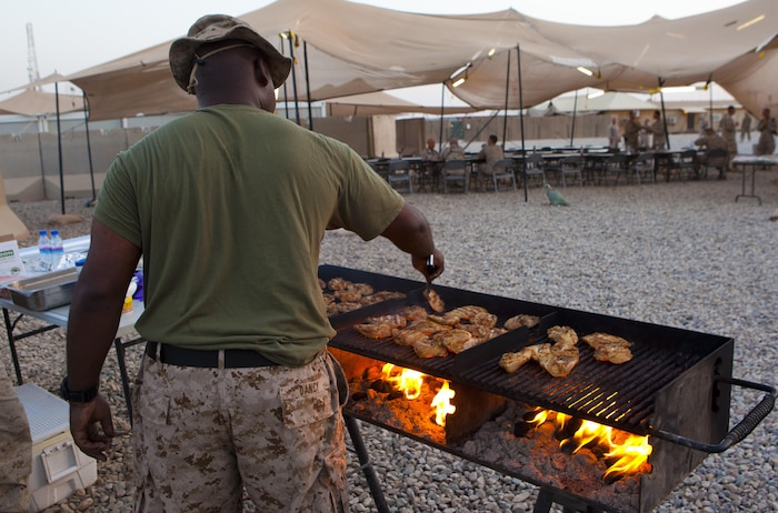 A food service specialist with Combat Logistics Regiment 2, Regional Command (Southwest), grills hamburger patties at Camp Leatherneck, Helmand province, Afghanistan, Sept. 12, 2013. The unit hosted numerous senior commanders and provided on-site food service while the leaders discussed future operations.