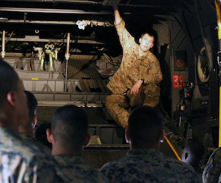 Air Force Technical Sgt. Talon Martin, a loadmaster with the 352nd Special Operations Group and St. Paul Park, Minn., native, instructs Marines and Airmen on the C-130, a military transport aircraft, aboard Mihail Kogalniceanu, Romania airbase, Sept. 12th. Black Sea Rotational Force-14 is an annual rotation to promote regional stability and security, increase military capacity and interoperability, as well as bolster and maintain partnerships with their counterparts in Eastern Europe. Black Sea Rotational Force 14 is a rotational deployment of Marines to the Black Sea region to work with partner and allied nations to help build their military capacity, provide limited crisis response capability, promote regional stability, and build enduring partnerships throughout Eastern Europe.