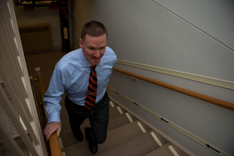 Heath Johnson walks up the stairs Sept. 6, 2013 at the Pentagon.  Since Feb. 25, 2103, Johnson has lost 91 lbs and no longer takes the elevator, but uses the stairs to get to his 5th story office. Johnson is the Air Force Personnel Organization Division chief.