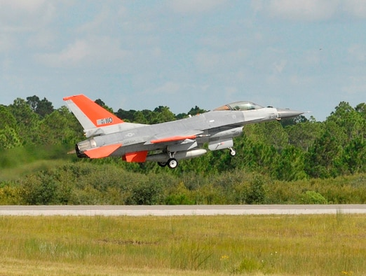 A QF-16 Full Scale Aerial Target from the 82nd Aerial Targets Squadron takes off on its first unmanned flight at Tyndall Air Force Base, Fla. Sept. 19, 2013. The 82nd ATRS operates the Department of Defense's only full-scale aerial target program. The QF-16 will provide a fourth generation fighter representation of real world threats . (U.S. Air Force photo/Staff Sgt. Javier Cruz)