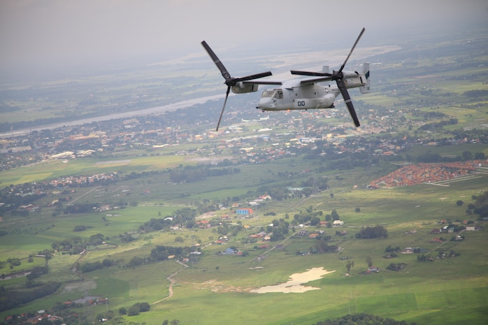 An MV-22B Osprey conducts a site-survey mission over Pampanga, Republic of the Philippines, Sept. 17 as part of Amphibious Landing Exercise 2014. The recurrence of PHIBLEX, now in its 30th year, demonstrates the U.S. and Republic of the Philippines' commitment to mutual security and their long-time partnership. The Osprey is with Marine Medium Tiltrotor Squadron 166, part of the 13th Marine Expeditionary Unit's aviation combat element.