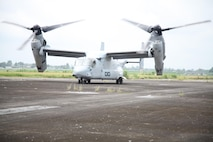 An MV-22B Osprey prepares to take off for a site-survey mission over Pampanga, Republic of the Philippines, Sept. 17 as part of Amphibious Landing Exercise 2014. The mission helped the Marines develop a more thorough understanding of the training areas. The Osprey is with Marine Medium Tiltrotor Squadron 166, part of the 13th Marine Expeditionary Unit's aviation combat element