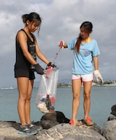 FORT DeRUSSY, OAHU - More than 35 volunteers picked up trash at Fort DeRussy in Waikiki in honor of National Public Lands Day on Sept. 21. The Corps of Engineers' Regional Visitor Center (RVC) coordinated the event which was supported by Corps employees and Punahou Junior ROTC cadets. In this photo JROTC cadets bag debris and trash on the beach berm behind historic Battery Randolph.