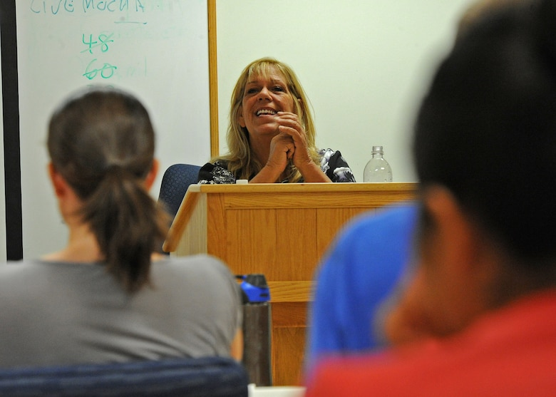 Mrs. Debra Blunt, a 19-year accredited financial counselor and 20-year military spouse teaches the Million Dollar Sailor/Airman course to a group of servicemembers and their spouses at the Military and Family Support Center at Joint Base Pearl Habor-Hickam, Hawaii, Sept. 18, 2013. Blunt was a creator of the course which originated in Hawaii.  The program was the first of its kind and has since spread Navy-wide.  (U.S. Air Force photo/Tech. Sgt. Jerome S. Tayborn)