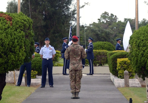 Staff Sgt. Aaron Davis, 320th Special Tactics Squadron combat controller, presents the POW/MIA flag to a member of the 18th Wing honor guard during the National POW/MIA flag ceremony Sept. 20, 2013 on Kadena Air Base, Japan.  National POW/MIA Recognition Day is one of six days throughout the year that Congress mandates the flying of POW/MIA flag.  (Air Force photo by Tech. Sgt. Kristine Dreyer)