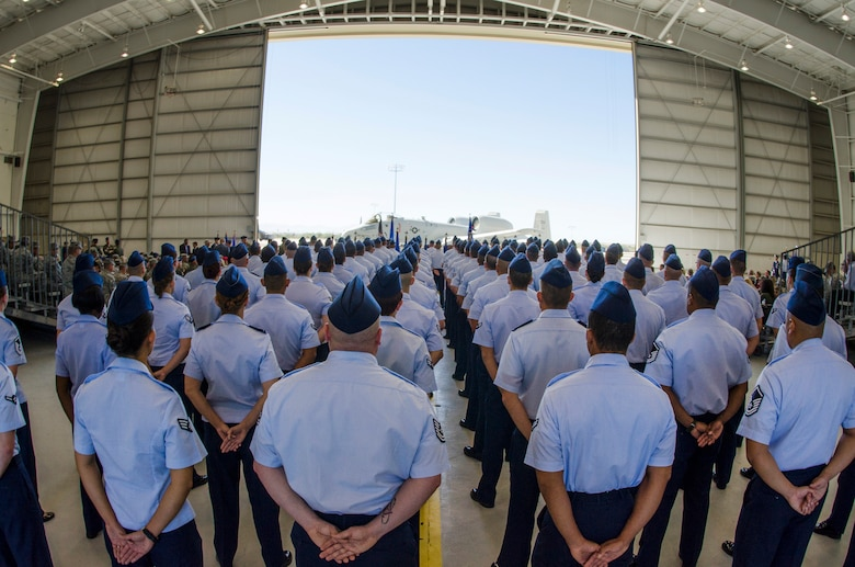 Airmen assigned to the 12th Air Force (Air Forces Southern) stand in formation during the 12th Air Force (Air Forces Southern) change of command ceremony on Davis-Monthan AFB, Ariz., Sept. 24, 2013.  Lt. Gen. Robin Rand relinquished command to Lt. Gen. Tod Wolters.  (U.S. Air Force photo by Staff Sgt. Heather R. Redman/Released)