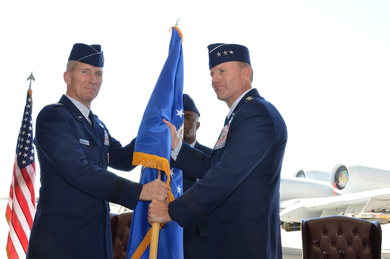 Gen. Mike Hostage, Commander, Air Combat Command, passes the guidon to Lt. Gen. Tod Wolters, 12th Air Force (Air Forces Southern) commander, during a change of command ceremony at Davis-Monthan Air Force Base, Ariz., Sept. 24, 2013. The passing of the guidon marks the beginning of Wolters tour as commander of 12th Air Force (Air Forces Southern). (U.S. Air Force photo by Staff Sgt. Adam Grant/Released)