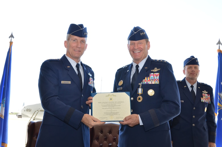 Gen. Mike Hostage, Commander, Air Combat Command, poses for a photo with Lt. Gen. Robin Rand, 12th Air Force (Air Forces Southern) commander, after being presented the Distinguished Service Medal during a change of command ceremony at Davis-Monthan Air Force Base, Ariz., Sept. 24, 2013. The Air Force Distinguished Service Medal is awarded to any member of the United States Air Force who has distinguished himself or herself by exceptionally meritorious service in a duty of great responsibility. (U.S. Air Force photo by Staff Sgt. Adam Grant/Released)