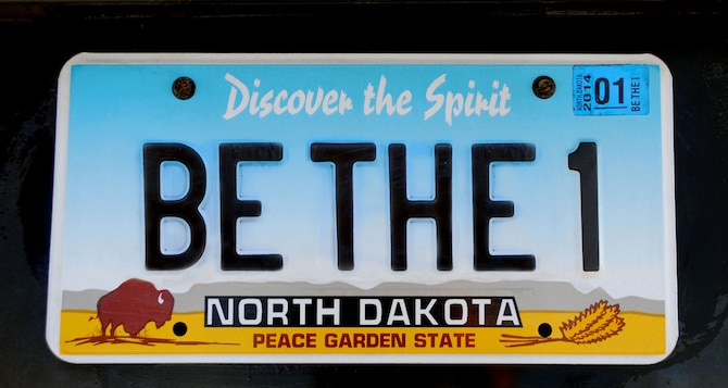 This psuedo North Dakota license plate was created as a complimentary image to 319th Mission Support Group commander, Col. Joe Lindsey's, commentary entitled Be the One. (U.S. Air Force graphic/Staff Sgt. Luis Loza Gutierrez) (This image was manipulated by adding text from multiple photos of other North Dakota license plates using the cloning tool feature on Adobe Photo Shop CS4)