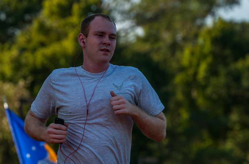 Senior Airman Eathain Duwe, 628th Medical Group medical laboratory technician runs during the POW/MIA Run Sept. 20, 2013, at Joint Base Charleston – Air Base, S.C. Different units from the joint base carried the flag in 30-minute increments from 3:30 p.m. Sept. 19 to 3:30 p.m. Sept. 20 in honor of all POWs and MIAs. Over 660 runners participated in the vigil and logged nearly 2,000 miles. (U.S. Air Force photo/ Airman 1st Class Chacarra Neal)