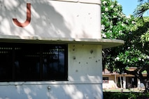 Bullet holes from the 1941 attacks on Pearl Harbor are still visible on the buildings at Joint Base Pearl Harbor-Hickam, Hawaii. (U.S. Air National Guard photo by Master Sgt. Kendra M. Owenby, 134 ARW Public Affairs/Released)
