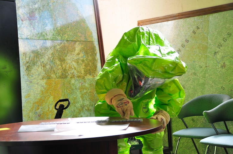 A member of the 134th Air Refueling Wing Civil Engineer Squadron Emergency Management team tests for a hazardous substance during a training exercise Joint Base Pearl Harbor- Hickam, Hawaii August 03-17.  (U.S. Air National Guard photo by Master Sgt. Kendra M Owenby/Released)