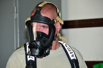 Airman First Class Brad Daugherty, 134th Civil Engineer Squadron Emegency Management, suits up in his self contained breathing apparatus during a a training exercise at Joint Base Pearl Harbor- Hickam, Hawaii August 03-17.  (U.S. Air National Guard photo by Master Sgt. Kendra M Owenby/Released)