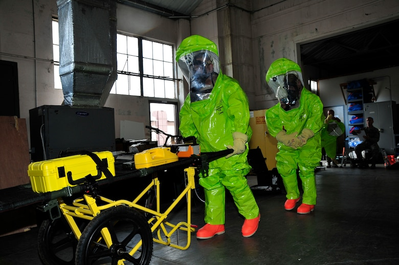 Members of the 134th Air Refueling Wing Civil Engineer Squadron Emergency Management team transport their equipment on site to test for a hazardous substance during a training exercise Joint Base Pearl Harbor- Hickam, Hawaii August 03-17.  (U.S. Air National Guard photo by Master Sgt. Kendra M Owenby/Released)